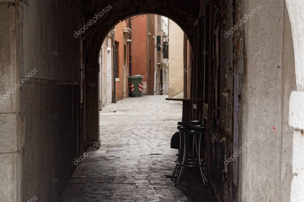 Фотообои Chioggia, Italy-August 26, 2018: Province of Venice. moped parked on a city street