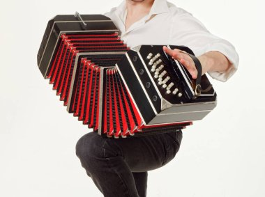 GOMEL, BELARUS - FEBRUARY 14, 2019: a bandoneon musical instrument in the hands of a musician
