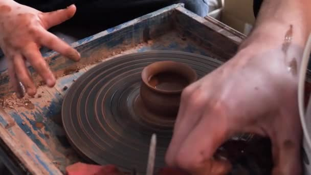 master class in pottery. potter's wheel and hands