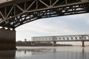 Railway bridge over the river Sozh in the sunset sunlight. Gomel. Belarus 2020