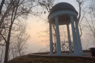 White arbor in the fog in the fall. Gomel, Belarus 2020