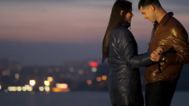 Happy lovers cuddle and dance against the background of a night city. tenderness love. Romantic evening