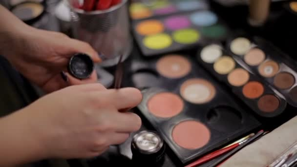 Professional cosmetics in the make-up salon. Luxurious cosmetics for make-up. Multicolored lipstick, shadows, powder, pencils close-up