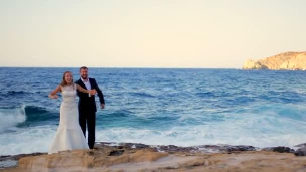 Happy Bride and groom on the seashore on their wedding day. Happy honeymoon concept