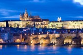 night view of Prague castle with st Vitus cathedral and gothic Charles bridge over Moldau river, Lesser town, Prague (UNESCO), Czech republic