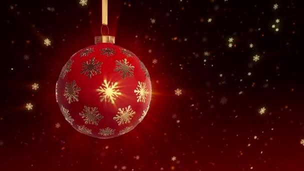 Vánoční strom míč rotuje na pozadí padajícího sněhu. pohyb smyčky