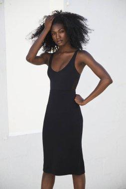 Stunning black girl in black dress, portrait