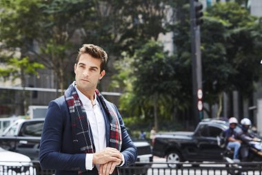 Smart city guy in scarf and jacket