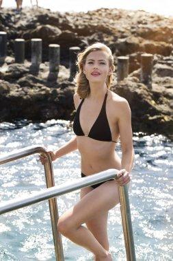 Stunning young woman in bikini, portrait
