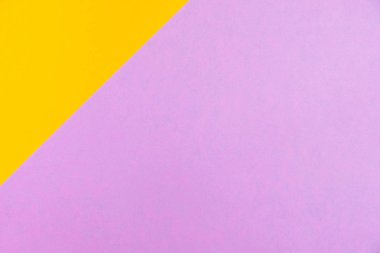 Pastel colored paper flat lay top view, background texture, pink, purple, yellow, orange colour.