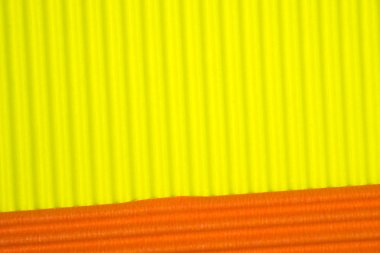 Yellow and orange corrugated paper texture, use for background.