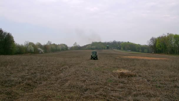 tractor on the field, old tractor plowing field, field with tractor