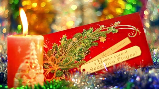 Christmas postcard and candle, Christmas candles, Christmas and New Year decoration with a lit candle and beautiful postcard