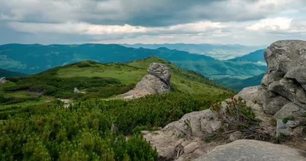 Tourists climb mountains time lapse, Sky in the mountains time lapse, Summer landscape in mountains and dark blue sky, sun shining and beautiful green hills time lapse, Group of  hikers with backpacks climbing mountain slope