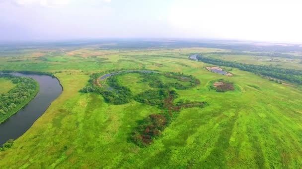 Aerial view of meadows, clouds over green meadows, Stunning aerial shot over lush green fields and meadows in the countryside, Shadows from clouds on green fields, Beautiful Landscape of Green Fields