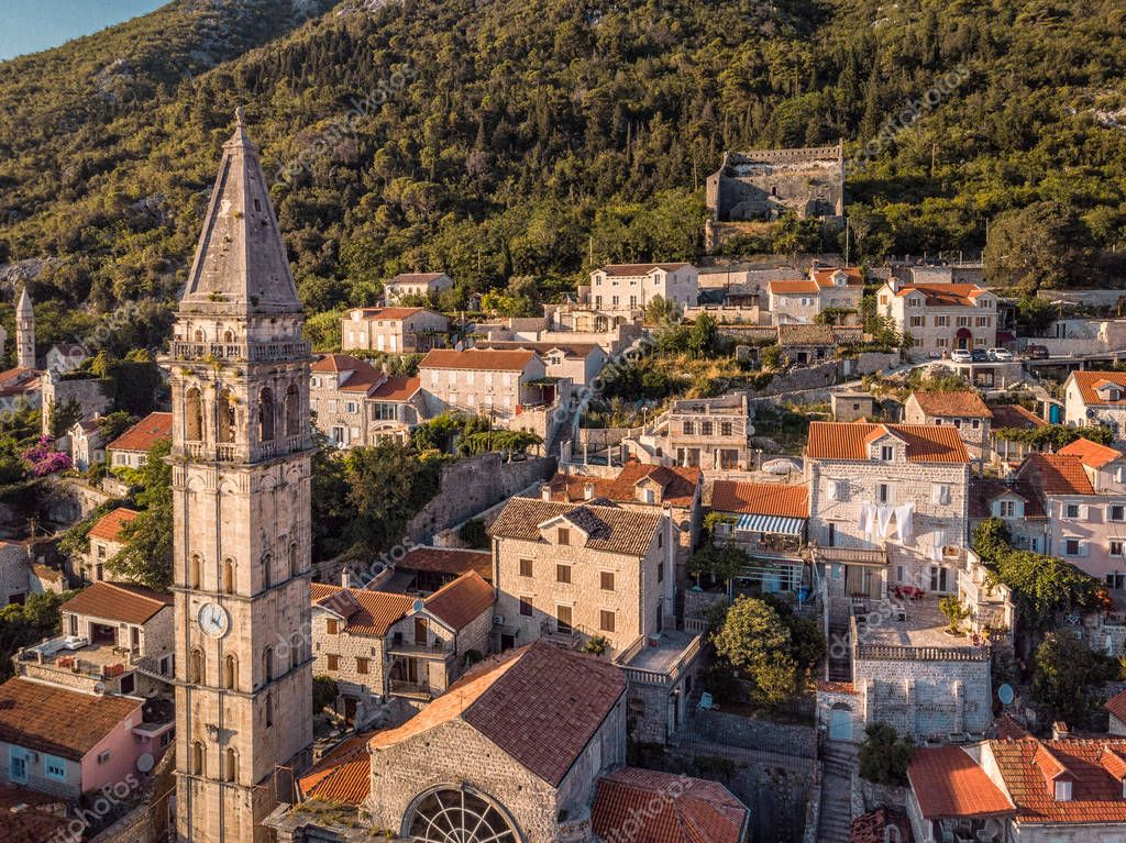 Kotor, Montenegro. Bay of Kotor bay is one of the most beautiful places on Adriatic Sea, it boasts the preserved Venetian fortress, old tiny villages, medieval towns and scenic mountains.