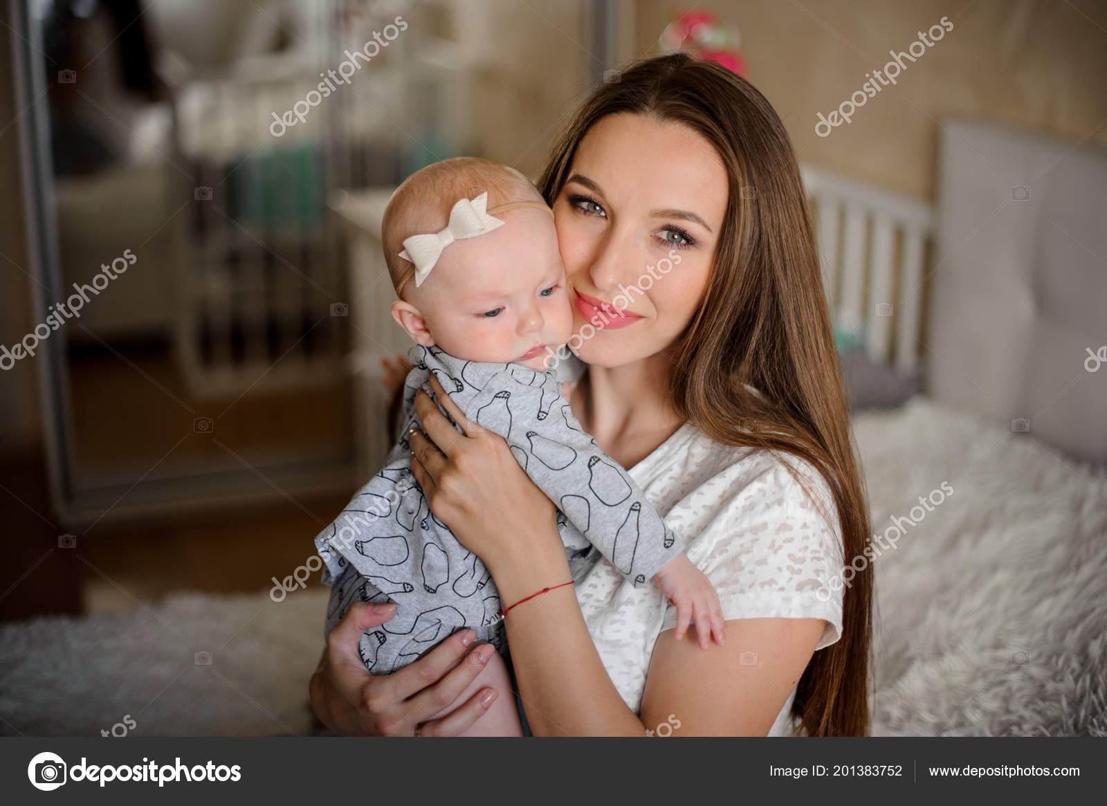 Young Brunette Mom Holding Her Little Blondie Daughter Hands Sweet Stock Photo