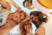 Photo summer, holidays, vacation, happy people concept - group of teenagers looking down
