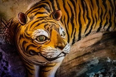 A stereoscopic tiger on a wall of a temple, which is a tiger in Taiwanese folk.