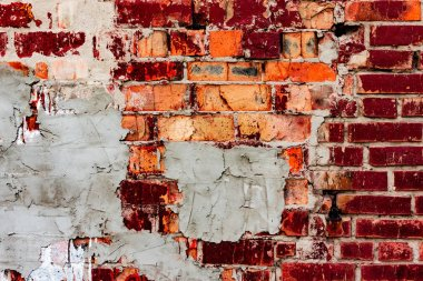 Texture of a brick wall with cracks and scratches which can be used as a background