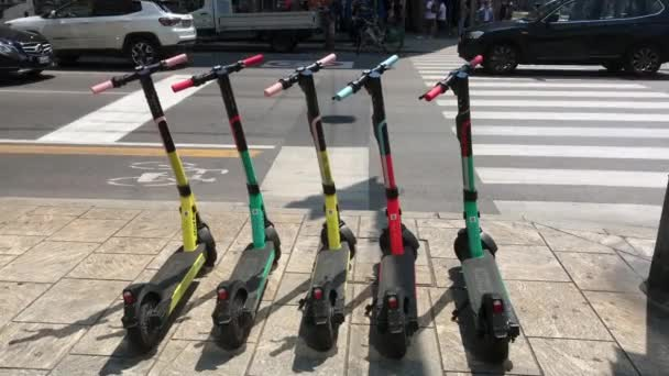 Europe, Italy, Milan - July 2020: electric scooter. Phase 2 covid19 Coronavirus, new rules of life for people and mobility - scooter and eco-sustainable mobility on the cycle path in downtown