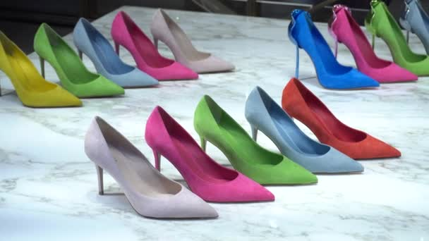 Italy , Milan - January 14,2020: colored shoes exposition in a store in Monte Napoleone road fashion district in downtown