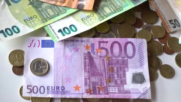 Euro money banknotes and coins cash on a white table