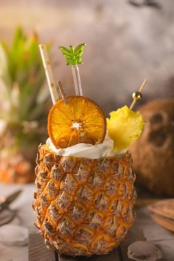 Exotic Pina Colada cocktail filled in fresh pineapple. Bar service.