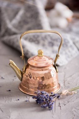 Old copper teapot and lavender flowers. Still life.