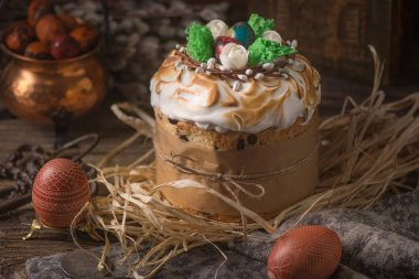 Traditional easter festive cake with merengue and almond. Dark rustic background. Russian Eastet kulich.