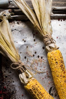 Grilled corn cob on metall background.