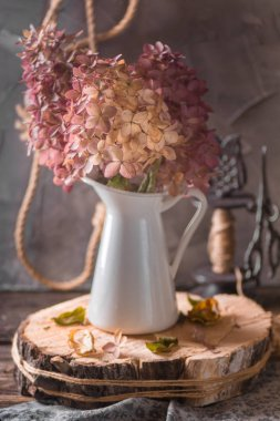 Beautiful bouquet of hydrangea in autumn interior.