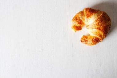 freshly baked croissants on white background. French food. Breakfast