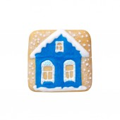 handmade christmas gingerbread blue house with snow isolated on white