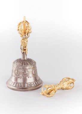 Traditional for Tibetan Buddhism a ritual hand bell and a dorje - symbols of unity of wisdom and sympathy. Are isolated on a white background.