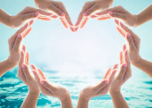 Photo Saving water and world water day for csr campaign concept with collaborative hands in love heart shape