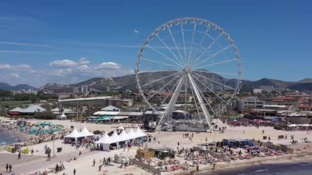 Aerial back traveling Prado beach Borely Marseille amusement park, Francie