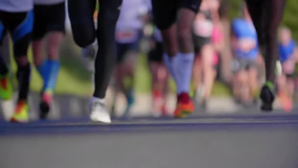 Beautiful slow motion on a group of runners from Marathon. Close view on legs