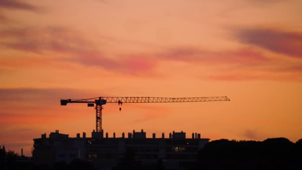 construction cranes at sunset Montpellier buildings France orange sky France