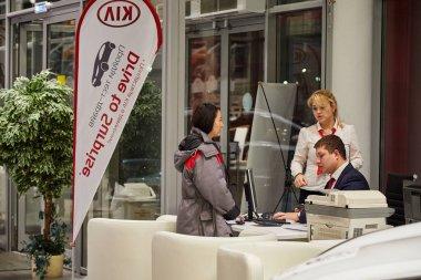 Kazan, Russia - October 16, 2018: Managers in showroom of dealership Kia in Kazan in 2018