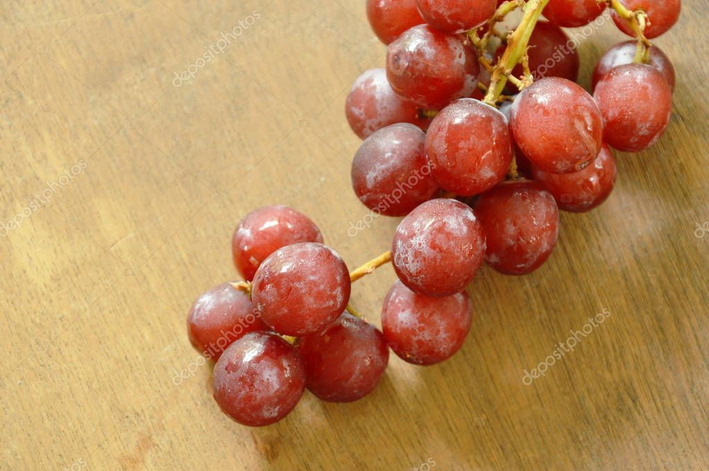 red grape on wooden board