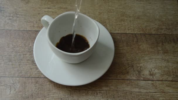 black coffee mixing by hot water pouring on glass
