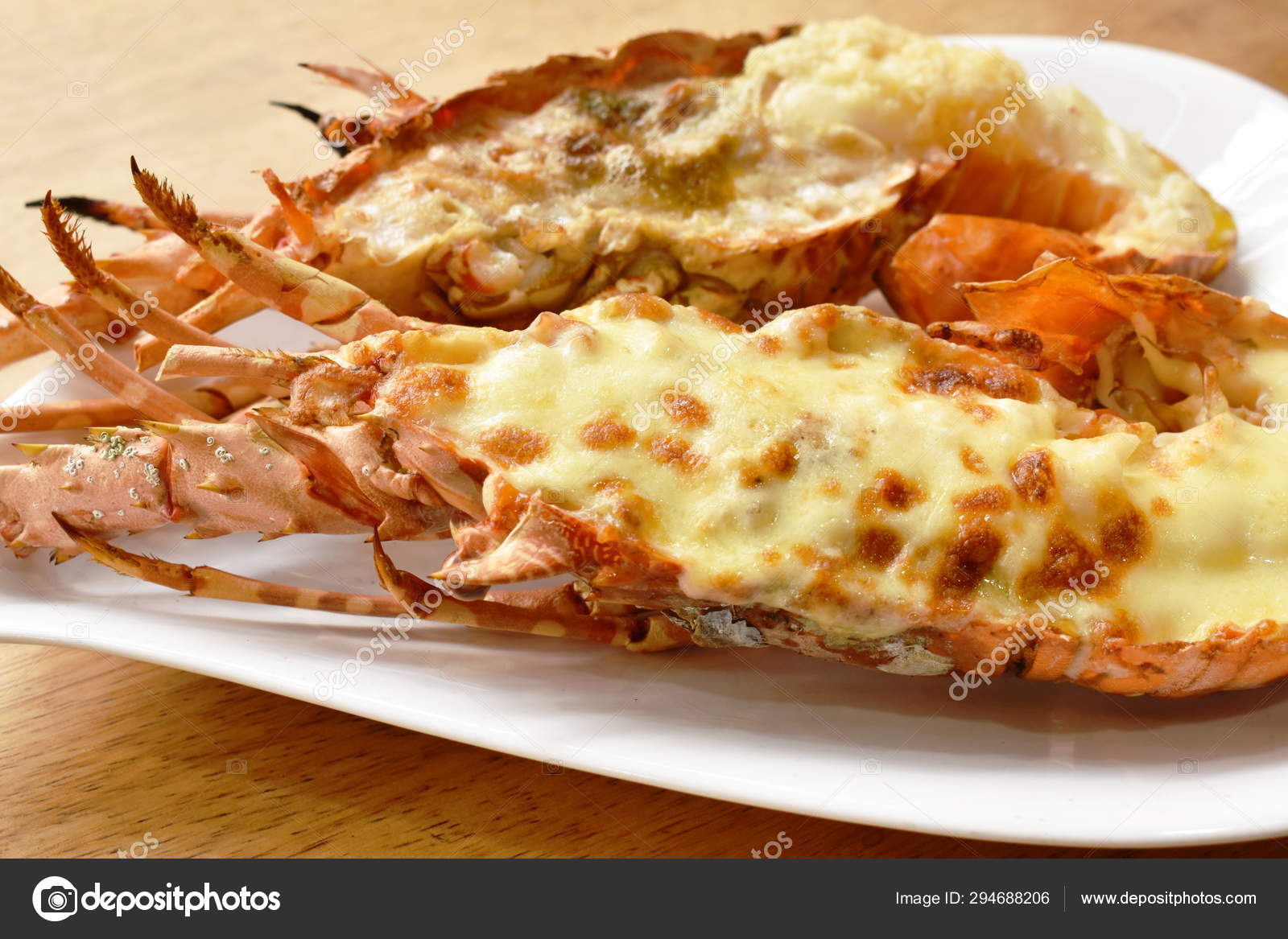 Grilled Lobster Shrimp With Cheese And Butter Garlic On Plate Stock Photo Image By C Pedphoto3pm 294688206