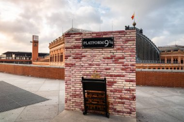 Platform nine and three quarters of Harry Potter in Atocha Station of Madrid