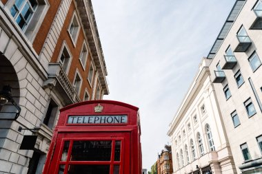 Iconic traditional red telephone box in London