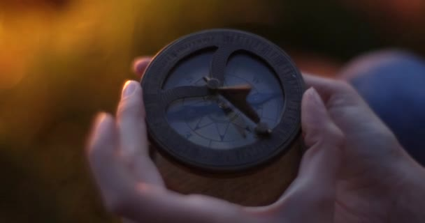 Old compass in hand