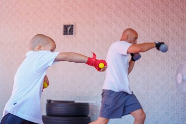 Boxing training in the gym, the concept of sports development.