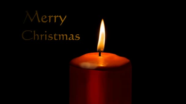 Burning red candle isolated on black background and animated title Merry christmas and Happy New Year, flying gold letters, animated headline, Christmas animation
