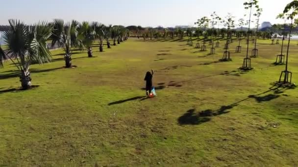 Girls running kites on the lawn with top view video 4K,