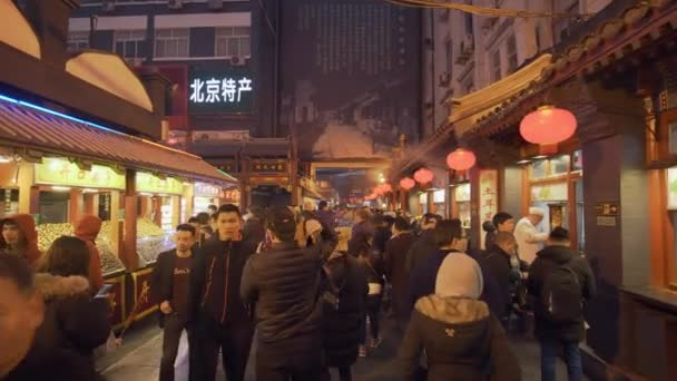 Beijing, China - Mar 17, 2018: 4k video of people at the Wangfujing Snack Street in Beijing